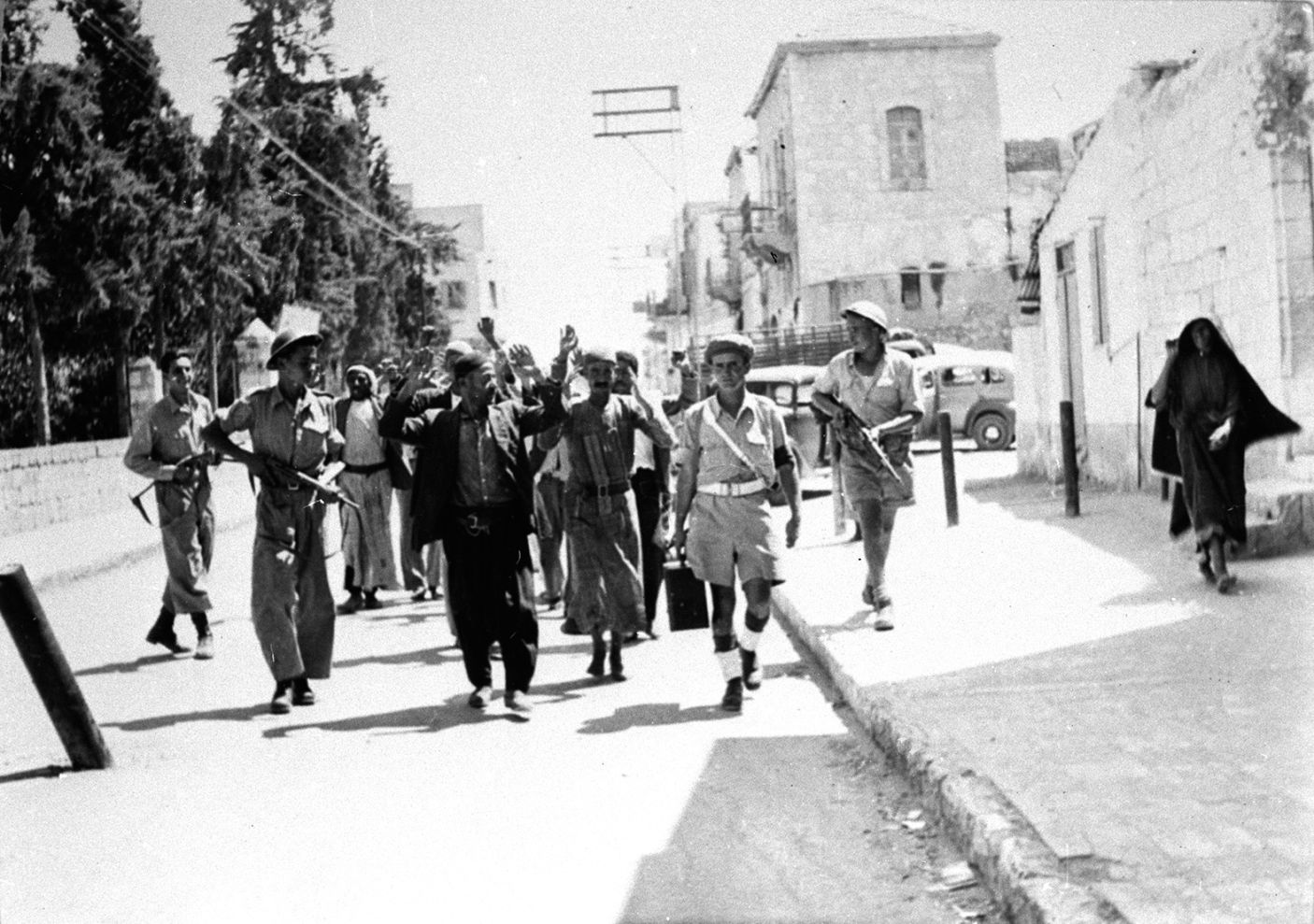 IDF soldiers guarding Palestinians in Ramle, in 1948. Collection of Benno Rothenberg/The IDF and Defense Establishment Archives